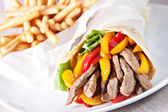 Fajitas with fries on the plate — Stock Photo