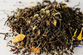 Dried tea leaves with aromatic additives — Stock Photo