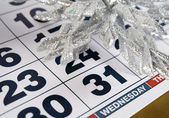 Calendar for December with silver Christmas decorations — Stock Photo