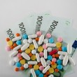 Medicines, tablets on the banknotes of 100 euros — Stock Photo #60263153