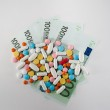 Medicines, tablets on the banknotes of 100 euros — Stock Photo #60263155
