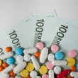 Medicines, tablets on the banknotes of 100 euros — Stock Photo #60263157