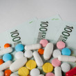 Medicines, tablets on the banknotes of 100 euros — Stock Photo #60263167