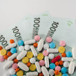 Medicines, tablets on the banknotes of 100 euros — Stock Photo #60263171