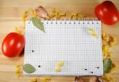 Notepad on the background of pasta, tomato and spices — Foto Stock
