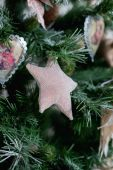 Christmas toys-star, closeup on the tree — Stock fotografie