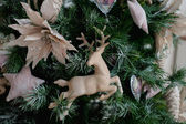 Christmas toys - deer, closeup on the tree — Stockfoto