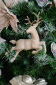 Christmas toys - deer, closeup on the tree — Stock Photo