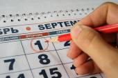 Date 1 September on the calendar circled in red circle hand — Stock Photo
