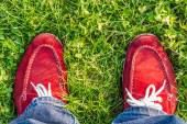 Enjoying free day outdoors wearing red shoes, standing on green lawn in the country, freedom, happiness — Stock Photo
