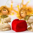 Two Christmas angels and red velvet heart on white background — Stock Photo #55882419