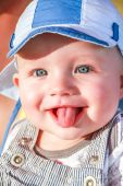 Baby boy is shooting tongue at people — Stock Photo