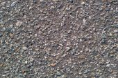 Grey concrete background with little stones — Stock Photo