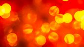 Abstract red blurred background with golden bright circles — Stock Photo