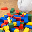 Child is playing with multicolored cubes — Stock Photo #57937291