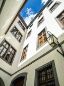 View of an old building in city centre with sky and clouds — Стоковое фото