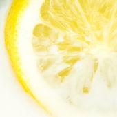 Closeup view of lemon dipped in milk — Stock Photo