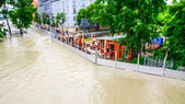 Extreme floods in Europe with ordinary life behind flood-protection — Stock Photo