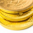 Three one ounce golden coins — Stock Photo #63591205