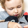 Young boy is taking care of his toys — Stock Photo #66957959