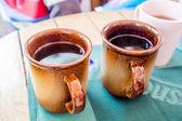 Break time with hot tea in apres ski bar — Stock Photo