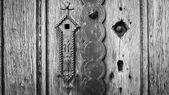 Old wooden door in black and white vignetting vintage style  — Stock Photo