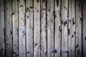 Uncared wooden fence with vignetting — Stock Photo