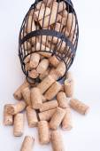 Cork cage filled with blank wine corks lies on white surface  — Stock Photo
