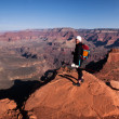 One female hiker standing at a cliff in Grand Canyon — Stock Photo #56942723