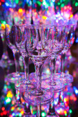 Set of small crystal liqueur glasses on background of colorful l — Stock Photo