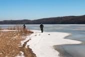 Men riding fat-bikes along frozen Mississippi River — ストック写真