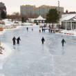People skate at early evening on a frozen lake — Stock Photo #62358971