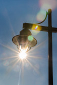 Gas lamp backlit by afternoon sun — Stock Photo