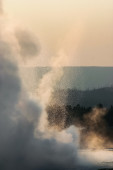 Steam and spray of a geyser at sunset,  Yellowstone NP — Stock Photo