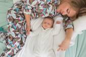 Sleeping mother and two month old baby boy  — Stock Photo