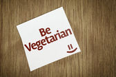 Be Vegetarian on Paper Note on texture background — Stock Photo