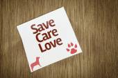 Save Care Love on Paper Note on texture background — Stock Photo