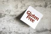 Gluten Free on Paper Note on texture background — Foto de Stock