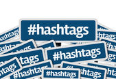 Hashtags written on multiple blue road sign — Stockfoto