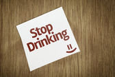 Stop Drinking on Paper Note on sky background — Stock Photo