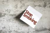 Stop Smoking on Paper Note on sky background — Foto de Stock