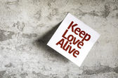 Keep Love Alive on Paper Note on texture background — Stock Photo