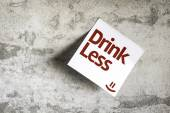 Drink Less on Paper Note on texture background — Stock Photo