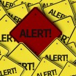Alert! written on multiple road sign — Stock Photo #54398621
