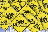 Gain Muscle written on multiple road sign — Stock Photo