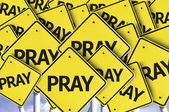 Pray written on multiple road sign — Stock Photo