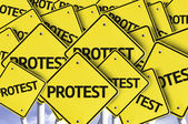 Protest written on multiple road sign — Stock Photo