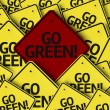 Go Green! written on multiple road sign — Stock Photo #54400441