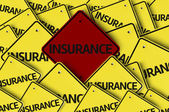 Insurance written on multiple road sign — Stock Photo