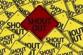 Shout Out written on multiple road sign — Stock Photo